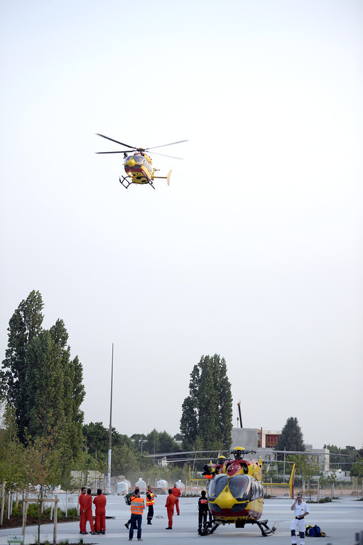 . A helicopter takes to the air as rescuers prepare to evacuate victims on the site of a train accident on July 12, 2013 at the railway station of Bretigny-sur-Orge, near Paris.  AFP PHOTO / MARTIN  BUREAU/AFP/Getty Images