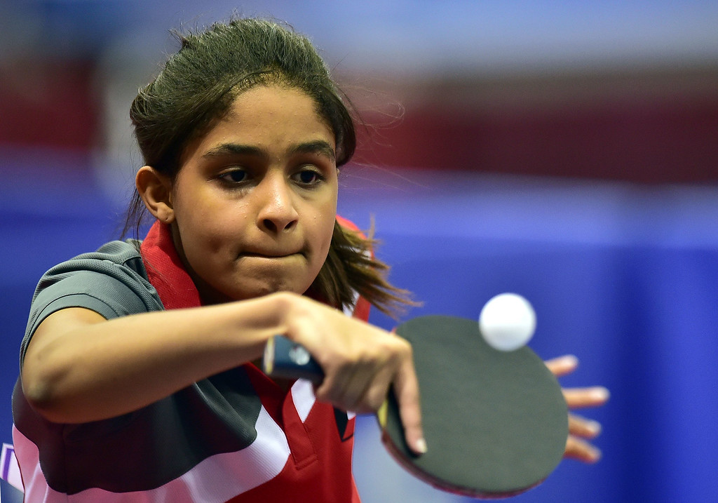 . Kuwait\'s Salem Noor serves to Macao\'s U Sio Mei in the women\'s team preliminary round table tennis event during the 2014 Asian Games at Suwon Gymnasium in Suwon, outside Incheon, on September 27, 2014.  JUNG YEON-JE/AFP/Getty Images