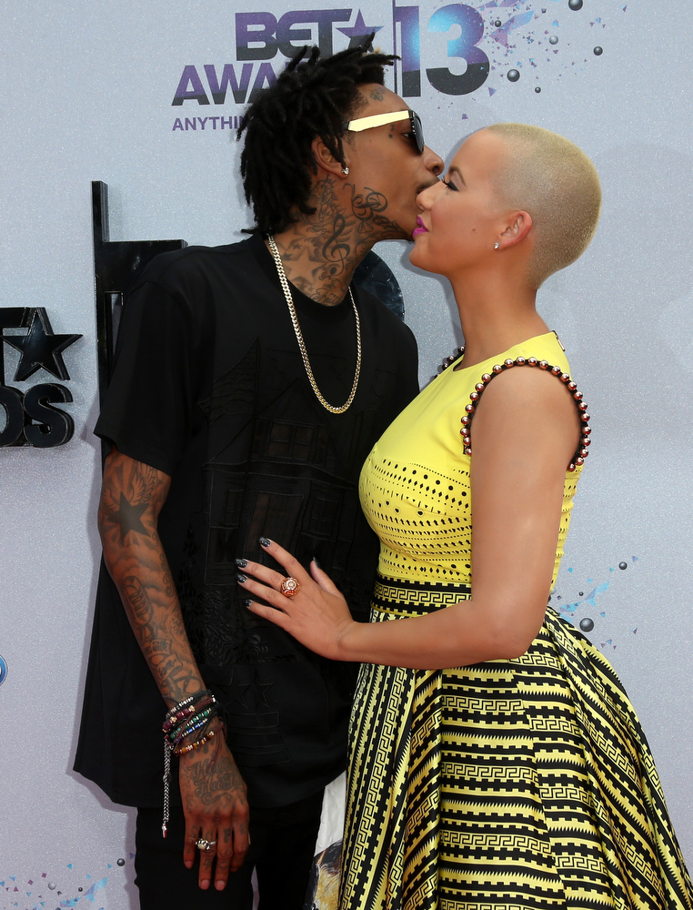Description of . Rapper Wiz Khalifa (L) and model Amber Rose attend the 2013 BET Awards at Nokia Theatre L.A. Live on June 30, 2013 in Los Angeles, California.  (Photo by Frederick M. Brown/Getty Images for BET)