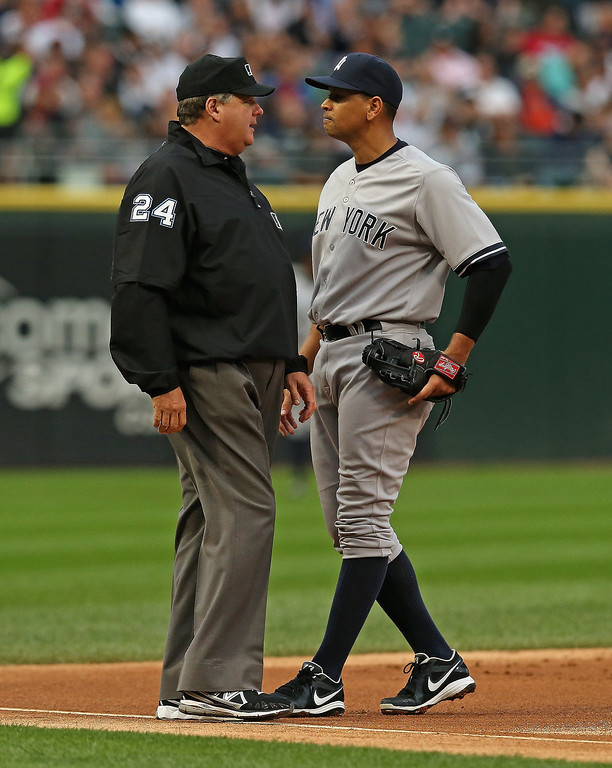 . Alex Rodriguez #13 of the New York Yankees talks with third base umpire Jerry Layne #24 during a game against the Chicago White Sox at U.S. Cellular Field on August 5, 2013 in Chicago, Illinois.  (Photo by Jonathan Daniel/Getty Images)