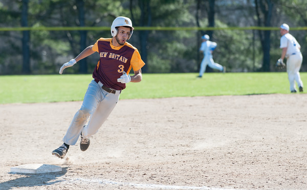 04/23/18 Wesley Bunnell | Staff New Britain baseball defeated Southington 9-8 in extra innings on Monday afternoon in a contest played at Southington High School. Guillermo Burgos (3) rounds third base on his way to score.