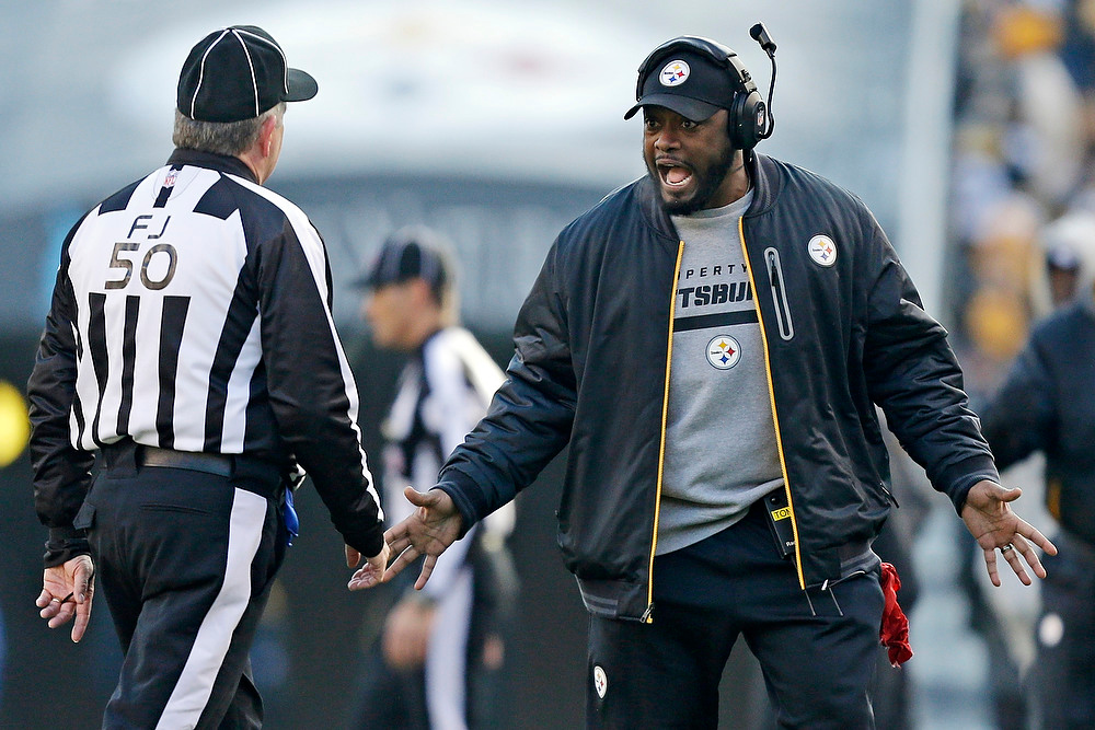 . Pittsburgh Steelers coach Mike Tomlin, right, makes a point to field judge Mike Weir (50) during the first quarter of an NFL football game against the Cincinnati Bengals in Pittsburgh, Sunday, Dec 23, 2012. The Bengals won 13-10. (AP Photo/Gene J. Puskar)