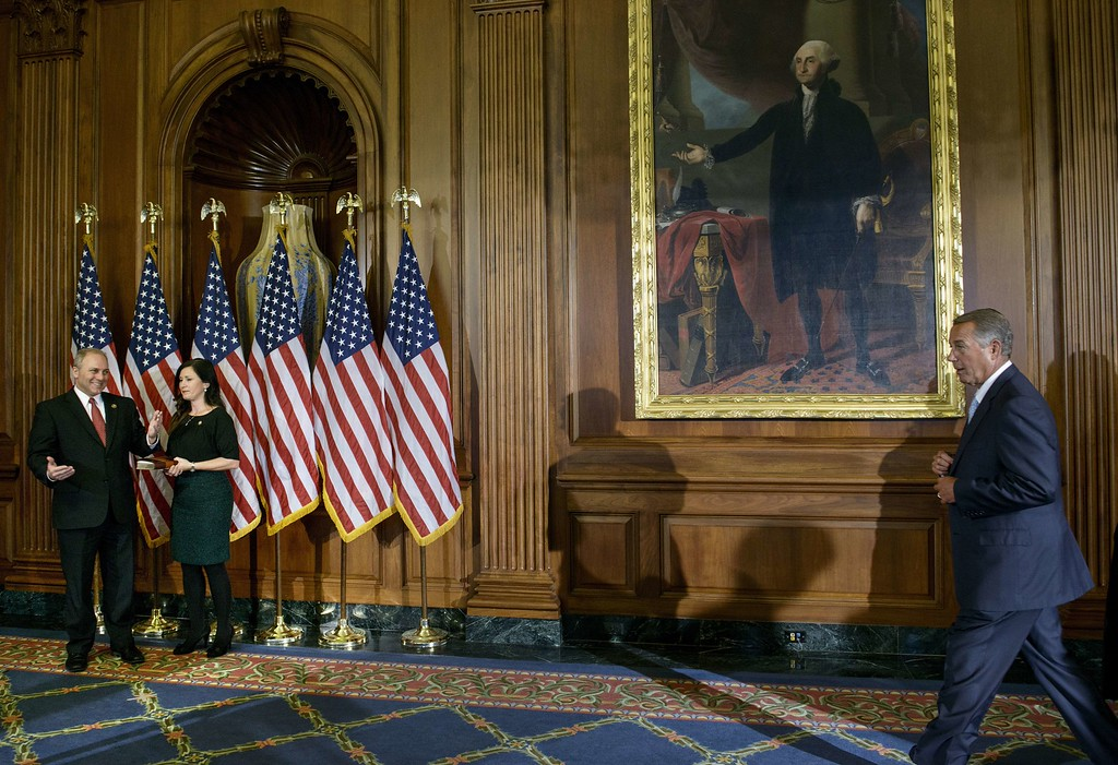 . Speaker of the House John Boehner(R) R-OH walks toward Rep. Steve Scalise (R-LA)  and his wife Jennifer  Scalise during a mock swearing-in ceremony on Capitol Hill January 6, 2015 in Washington, DC. The 114th Congress convened today with Republicans taking majority control of both the Senate and House of Representatives. Republican John Boehner was re-elected and sworn in Tuesday as speaker of the US House of Representatives, overcoming a surprisingly robust attempt to oust him by two dozen hardcore conservatives. Boehner received 216 of the 408 votes cast in the chamber, winning as expected over Democrat leader and former House speaker Nancy Pelosi, who received 164 votes. BRENDAN SMIALOWSKI/AFP/Getty Images