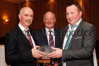 Joe McCarragher and son Colin, Richhill, won the Co Armagh UFU Winter Barley Competition and are pictured at the County Armagh dinner receiving their award from Billy Morton, left, Chairman, Co Armagh UFU. Photograph: Columba O'Hare