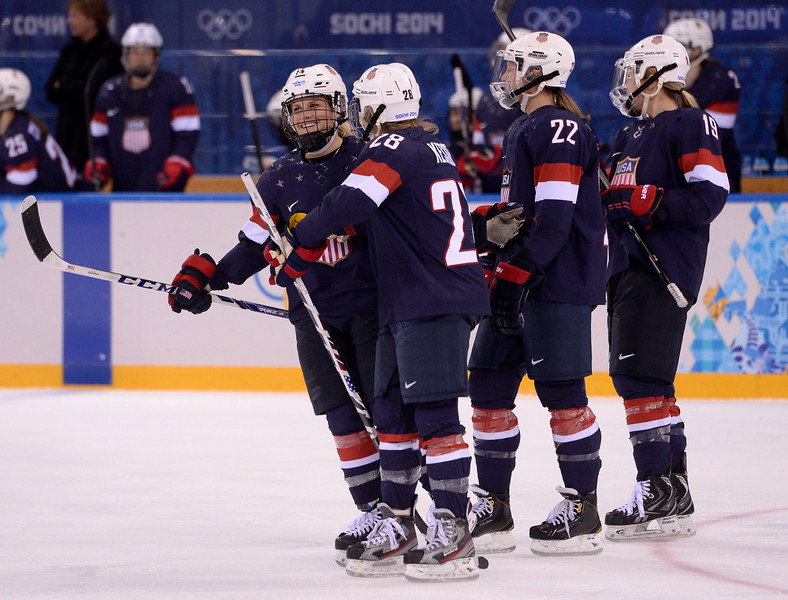 . US Brianna Decker (L) and her team mates Amanda Kessel (2L), Kacey Bellamy and Gigi Marvin (R) celebrate during the Women\'s Ice Hockey Semifinals USA vs Sweden at the Shayba Arena during the Sochi Winter Olympics on February 17, 2014.     AFP PHOTO / ANDREJ ISAKOVICANDREJ ISAKOVIC/AFP/Getty Images