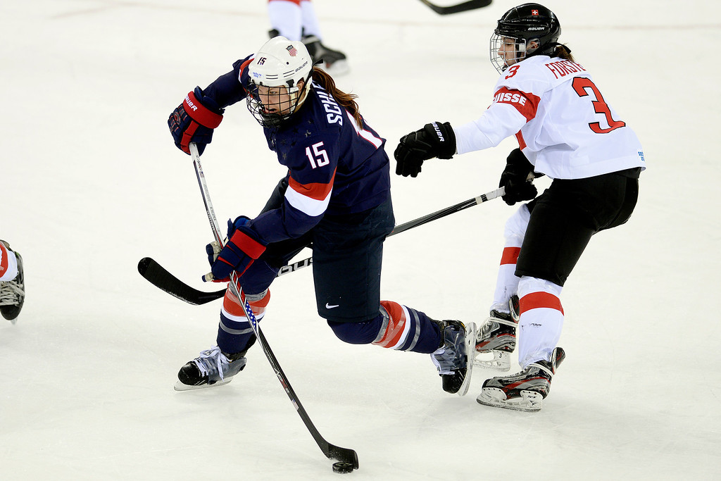 . Anne Schleper (15) of the U.S.A. controls the puck as Sarah Forster (3) of the Switzerland defends during the third period of the United States\' 9-0 win at the Shayba Arena. Sochi 2014 Winter Olympics on Monday, February 10, 2014. (Photo by AAron Ontiveroz/The Denver Post)