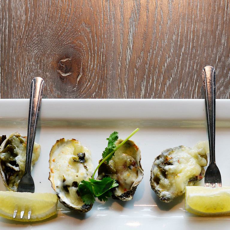 . North County\'s Charcoal Grilled Oysters is a popular dish at restaurant in the Lowry development in east Denver, April 02, 2015. North County specializes in coastal seafood, fresh fish tacos, and has a lively bar scene. (Photo by RJ Sangosti/The Denver Post)