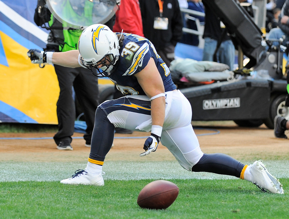. San Diego Chargers running back Danny Woodhead celebrates his six yard touchdown reception against the New York Giants during the first half of an NFL football game Sunday, Dec. 8, 2013, in San Diego. (AP Photo/Denis Poroy)