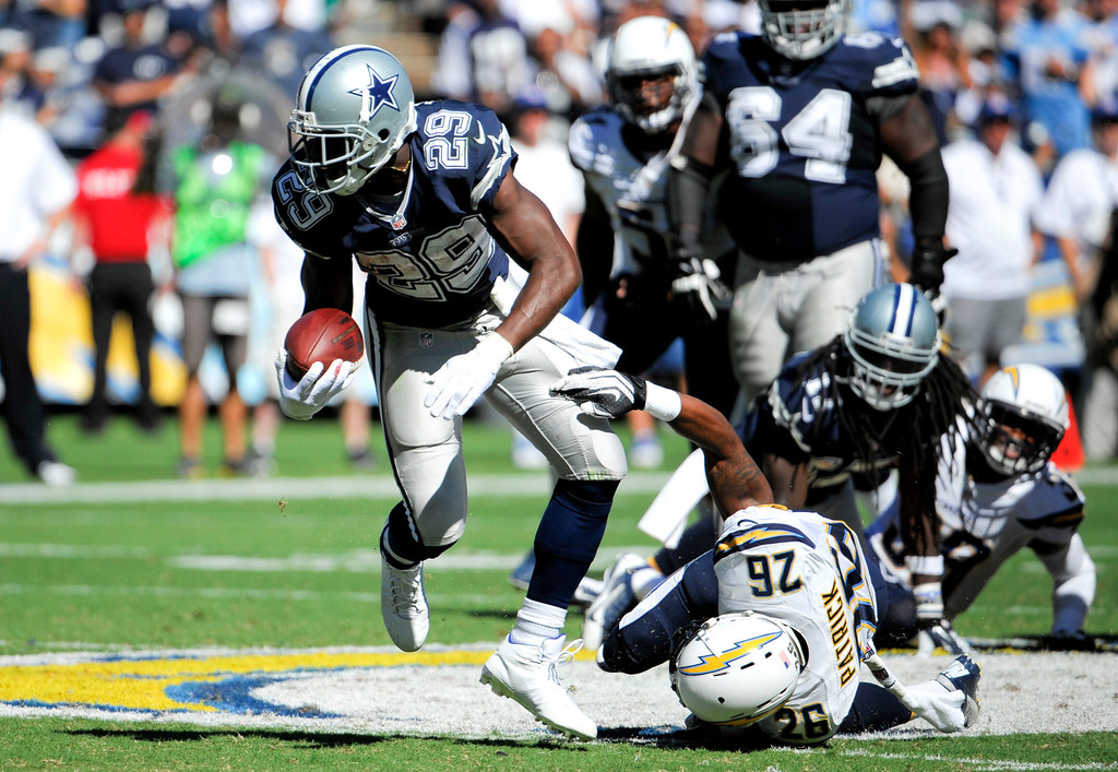 . Dallas Cowboys running back DeMarco Murray, left, breaks away form San Diego Chargers cornerback Johnny Patrick during the first half of an NFL football game Sunday, Sept. 29, 2013, in San Diego. (AP Photo/Denis Poroy)