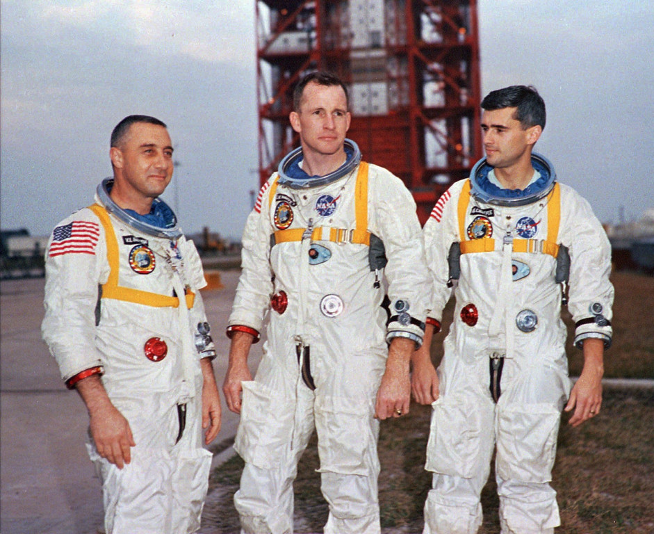""". Apollo 1 astronauts, from left, Virgil \""""Gus\"""" Grissom, Edward White II, and Roger Chaffee pose next to their Saturn 1 launch vehicle in this Jan. 17, 1967, photo at Launch Complex 34 at Cape Canaveral Air Station in Cape Canaveral, Fla. (AP Photo/NASA, ho)"""