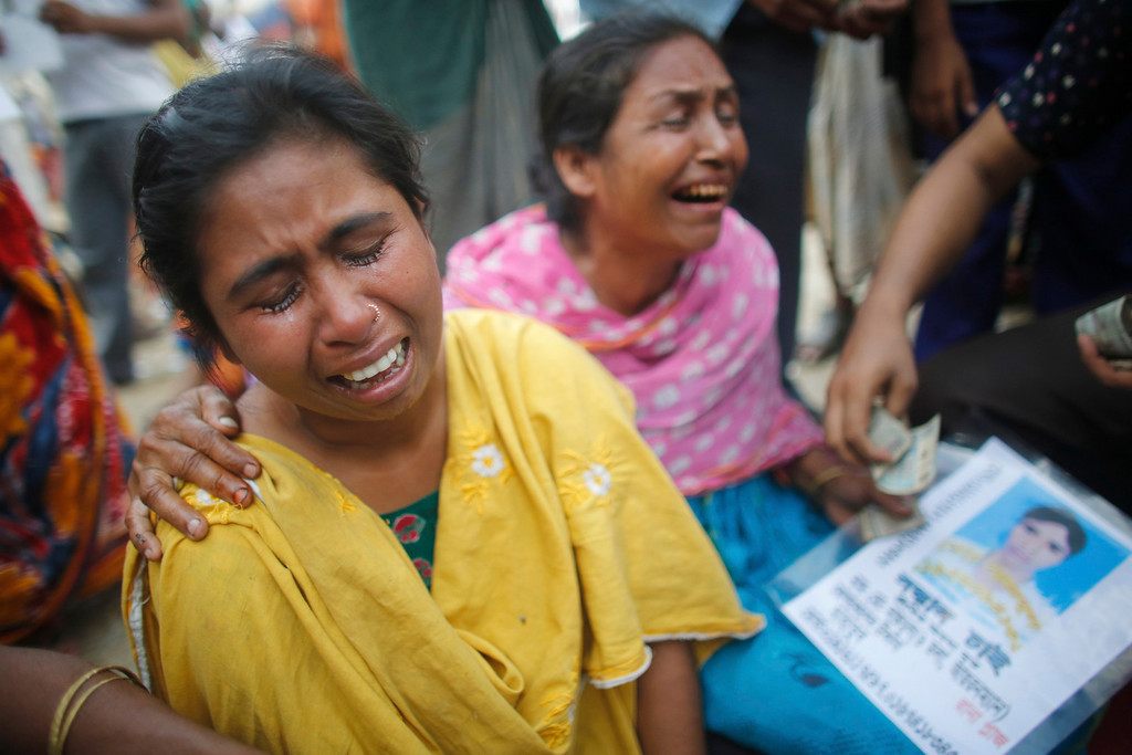 . Women cry as they wait for news of their relative, a garment worker who is still missing, after the collapse of the Rana Plaza building in Savar, outside Dhaka April 30, 2013.  REUTERS/Andrew Biraj