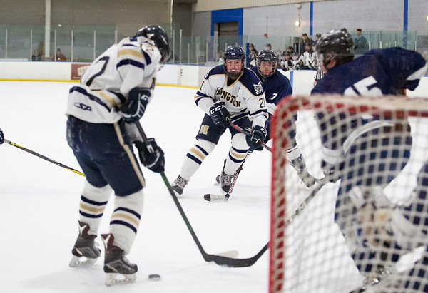 01/27/20 Wesley Bunnell | StaffrrNewington-Berlin hockey vs SLTN at Newington Arena on Monday afternoon. Justin Stergos (21) would be credited with a goal that appears to actually have deflected by Sam Hedlund (12).