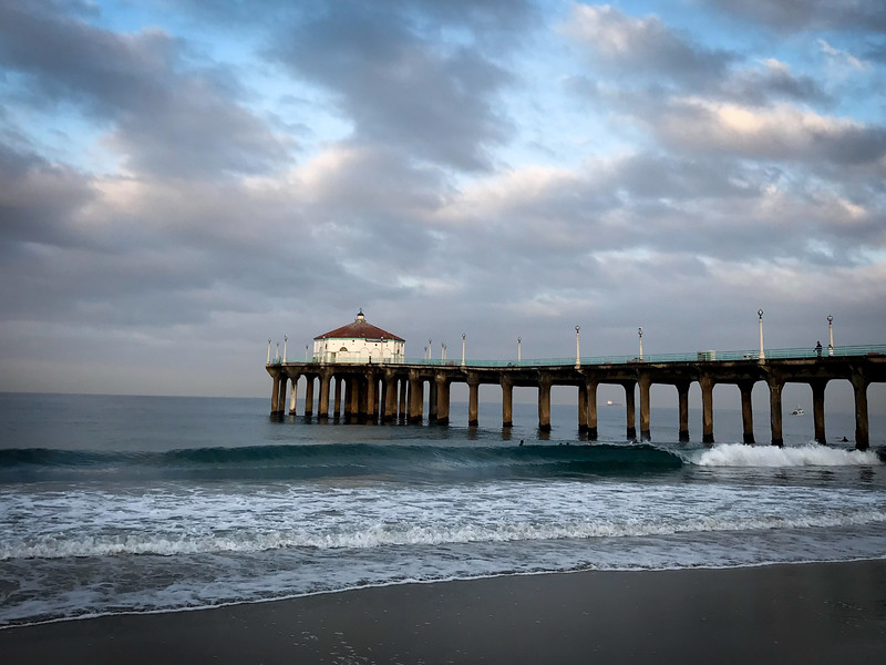 The Manhattan Beach Pier in the morning. Usually about 30 minutes after the sun rises, the Pier Roundhouse is lit up with a morning glow. The Pier was built in 1920