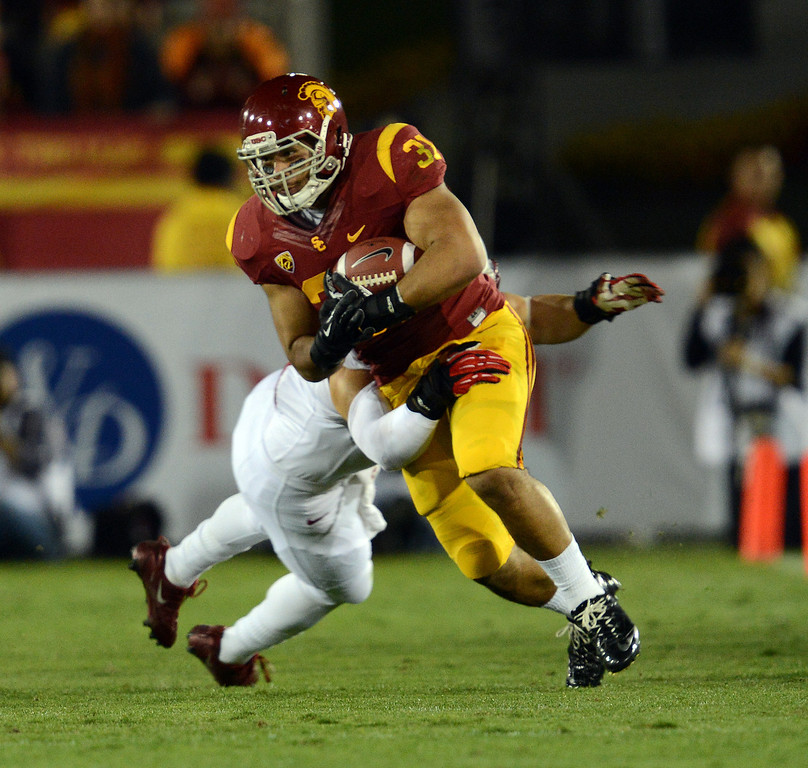 . USC�s Soma Vainuku #31 moves up field during their game against Stanford at the Los Angeles Memorial Coliseum Saturday, November 16, 2013. (Photos by Hans Gutknecht/Los Angeles Daily News)