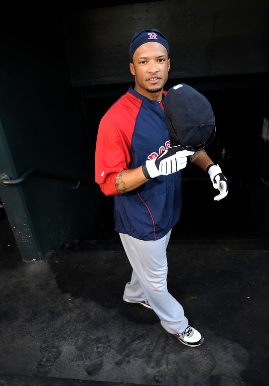 . Former Cherry Creek star now Boston Red Sox player Darnell McDonald heads to the clubhouse after batting practice before their game against the Colorado Rockies Tuesday, June 22, 2010 at Coors Field. John Leyba, The Denver Post