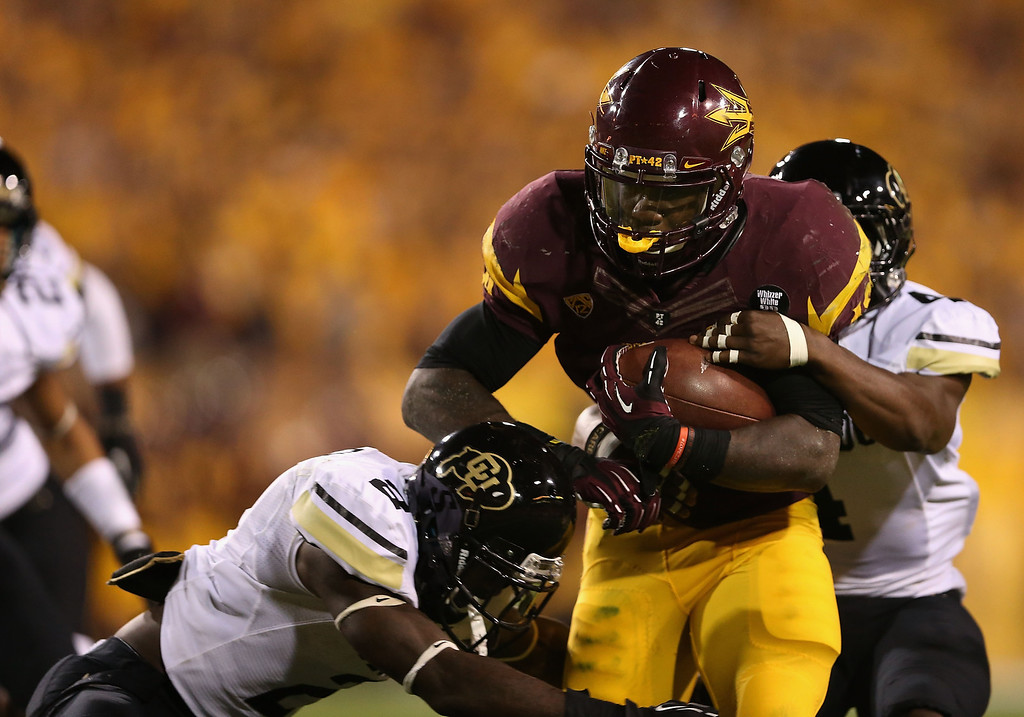 . TEMPE, AZ - OCTOBER 12:  Running back Marion Grice #1 of the Arizona State Sun Devils rushes the football against the Colorado Buffaloes during the college football game at Sun Devil Stadium on October 12, 2013 in Tempe, Arizona.  (Photo by Christian Petersen/Getty Images)