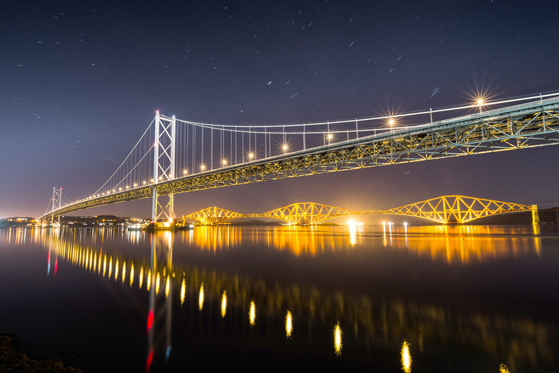 Forth Road Bridge and the Forth Bridge at Night