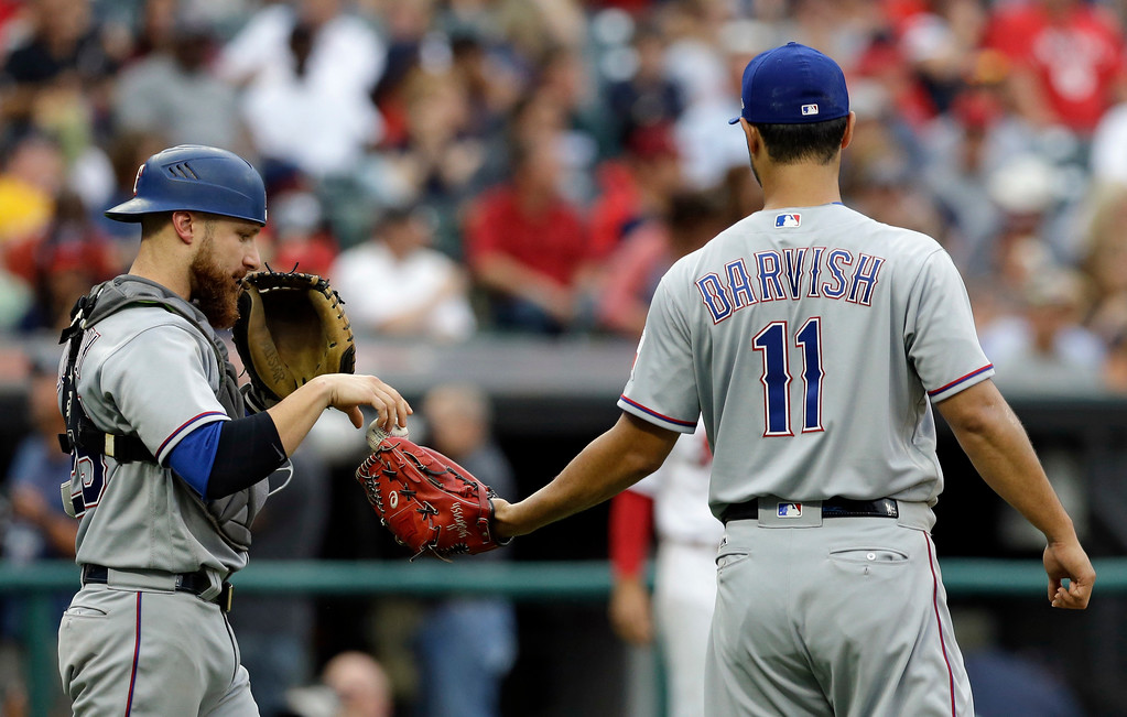 . Texas Rangers starting pitcher Yu Darvish gets a ball from catcher Jonathan Lucroy in the third inning of a baseball game against the Cleveland Indians, Wednesday, June 28, 2017, in Cleveland. (AP Photo/Tony Dejak)