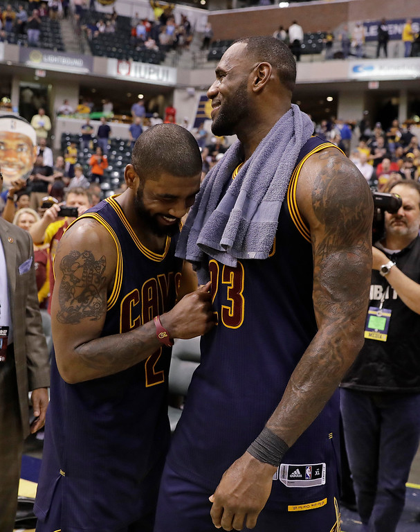 . Cleveland Cavaliers\' LeBron James, right, and Kyrie Irving celebrate after Cleveland defeated the Indiana Pacers 106-102 to win Game 4 of a first-round NBA basketball playoff series, Sunday, April 23, 2017, in Indianapolis. Cleveland won the series 4-0. (AP Photo/Darron Cummings)