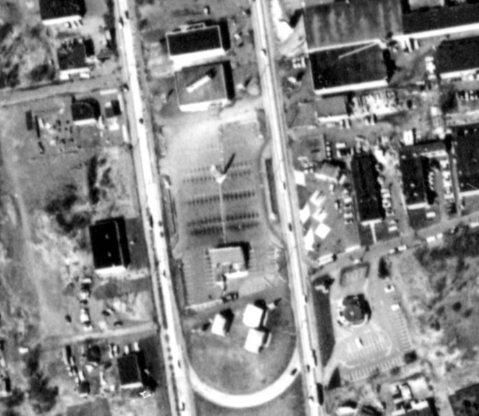 "Aerial photo showing the Adventure Car Hop in the center island of Route 22 in 1961. Currently Red Lobster stands at this site. Found on the web: ""Many nights spent racing at the Adventure Car Hop on Rte. 22. We would go in going east get some food, and then pool some guys to get up a race. We would pull out of the Adverture going west racing 3 and 4 cars wide. We had a 54 nail head Buick/stick/duels/california speed shop'isky cam/duel point ing/chemicals .. in the gas tank. The last race I remember there was a 4 car race and we were ahead, and all of a sudden we got passed by an ugly 49/50 chevy green I think. We all pulled over paid our 50 bucks and drove off into the future-we drove the police nuts I figure. I still have my haulin gents club plaque (Asbury Park). No street racing with those guys. Just nice street rides and car shows-STOCK CARS /RACEWAYPARK. LATER, TIM"""