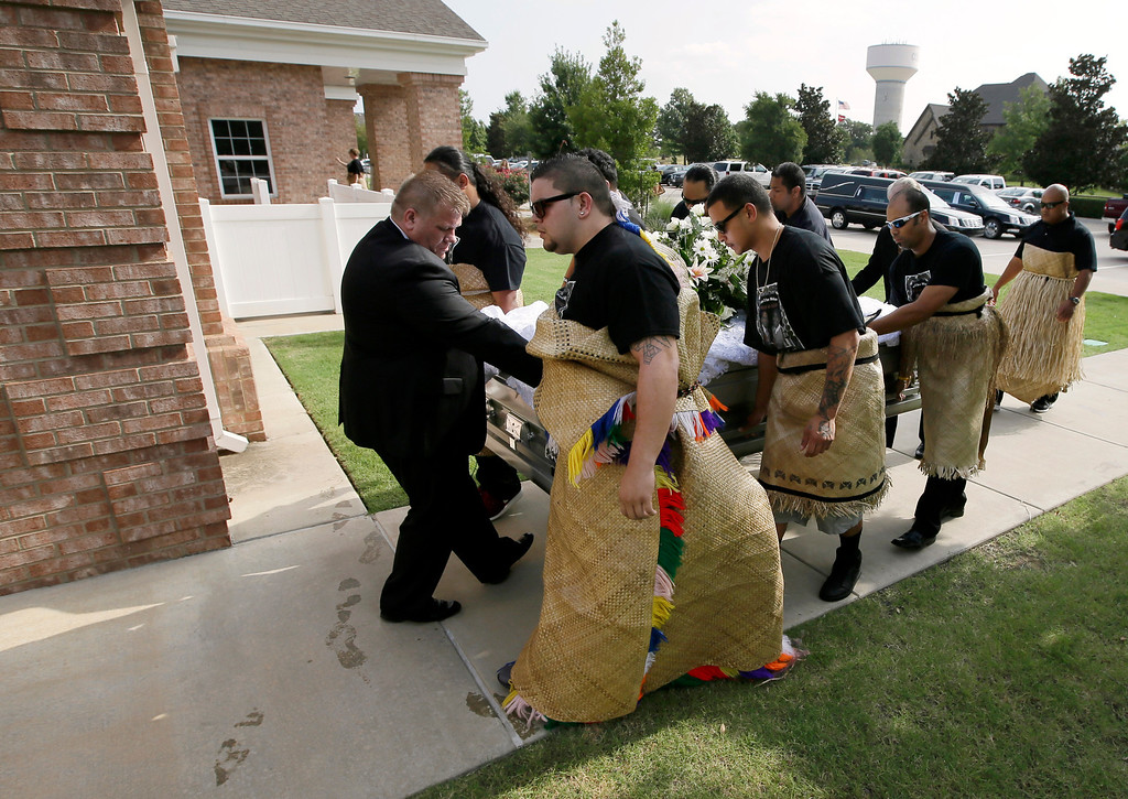 ". The casket of Texas A&M redshirt freshman Polo Manukainiu is led in to the Church of Jesus Christ Of Latter Day Saints before a funeral service for  Manukainiu and his brother Andrew Uhatafe, Saturday, Aug. 10, 2013, in Colleyville, Texas. The two were killed in a single car accident in Northern New Mexico, July 29. Also killed was 18-year-old Utah recruit Gaius ""Keio\"" Vaenuku. (AP Photo/Tony Gutierrez)"