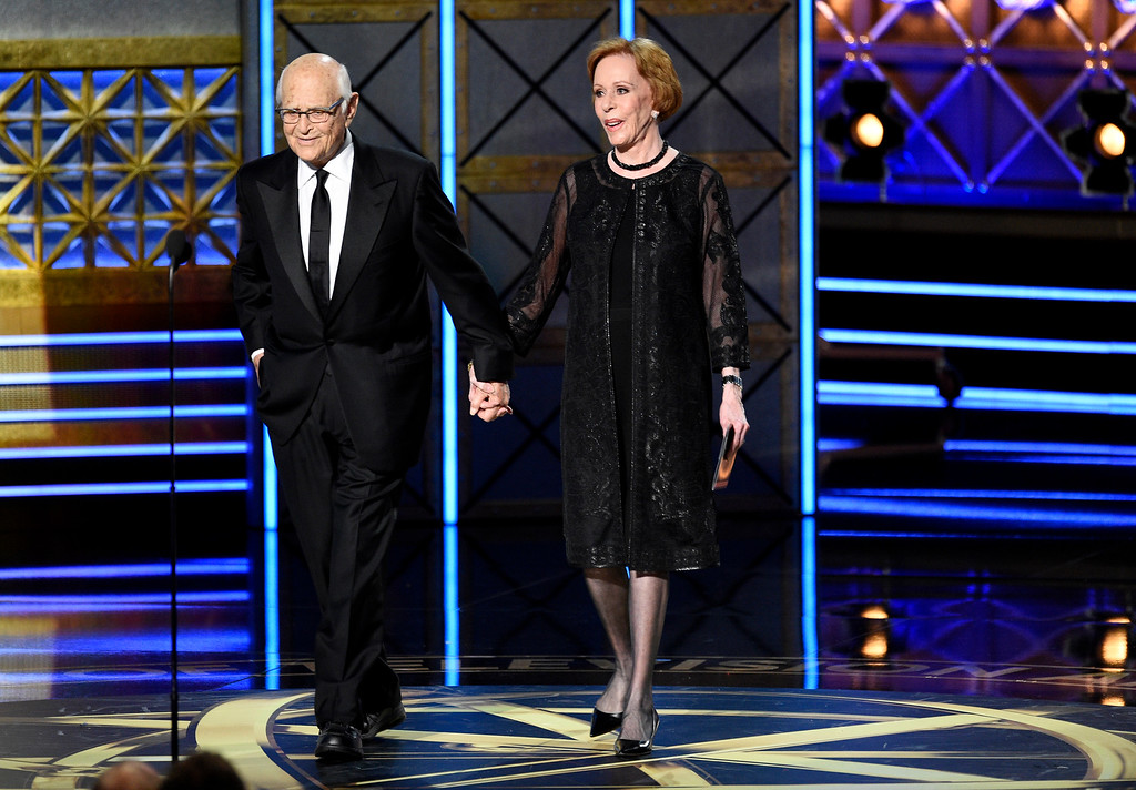 . Norman Lear, left, and Carol Burnett present the award for outstanding comedy series at the 69th Primetime Emmy Awards on Sunday, Sept. 17, 2017, at the Microsoft Theater in Los Angeles. (Photo by Chris Pizzello/Invision/AP)