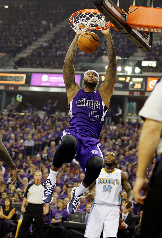 . Sacramento Kings center DeMarcus Cousins (15) dunks as Denver Nuggets point guard Nate Robinson (10) watches during the second quarter of an NBA basketball game Wednesday, Oct. 30, 2013, in Sacramento. (AP Photo/Genevieve Ross)