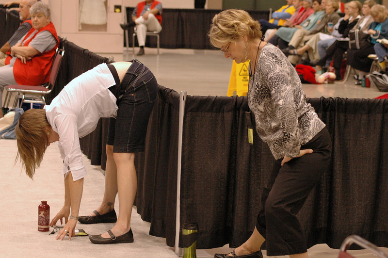 Voting members take a moment to strech during plenary session eight.