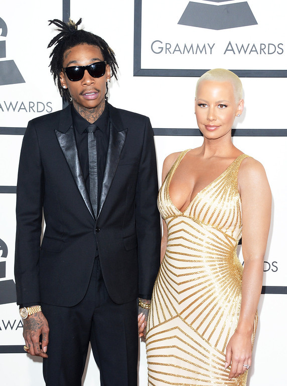 . Rapper Wiz Khalifa (L) and model Amber Rose attend the 56th GRAMMY Awards at Staples Center on January 26, 2014 in Los Angeles, California.  (Photo by Jason Merritt/Getty Images)