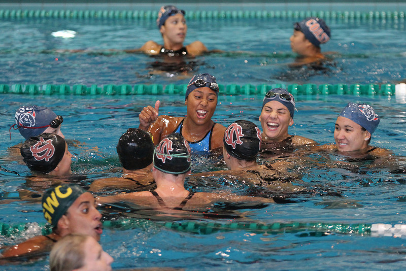 Sierra College and Santa Rosa share a laughing moment after 400 medley relay