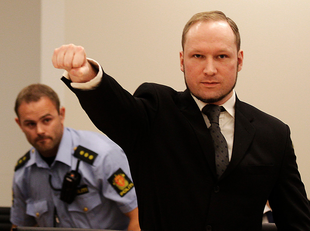 . In this Aug. 24, 2012 file photo, mass murderer Anders Behring Breivik, makes a salute after arriving in the court room at a courthouse in Oslo.   Breivik, who admitted killing 77 people in Norway last year, was declared sane and sentenced to prison for bomb and gun attacks. (AP Photo/Frank Augstein, File)
