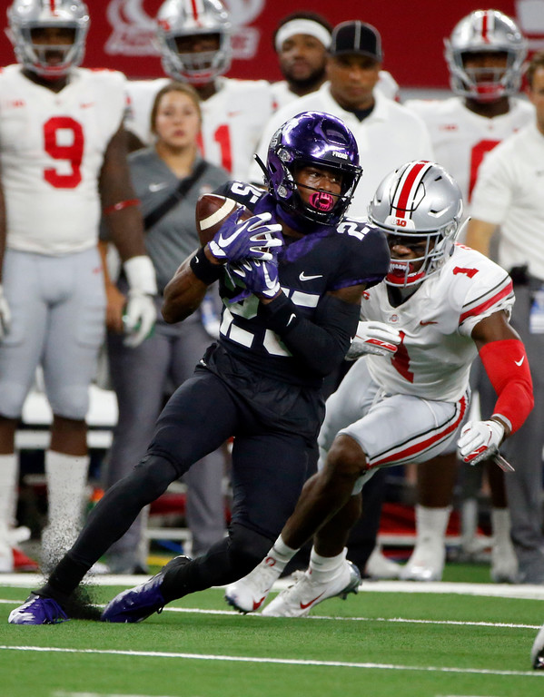 . TCU wide receiver KaVontae Turpin (25) catches a pass in front of Ohio State cornerback Jeffrey Okudah (1) during the first half of an NCAA college football game in Arlington, Texas, Saturday, Sept. 15, 2018. (AP Photo/Michael Ainsworth)