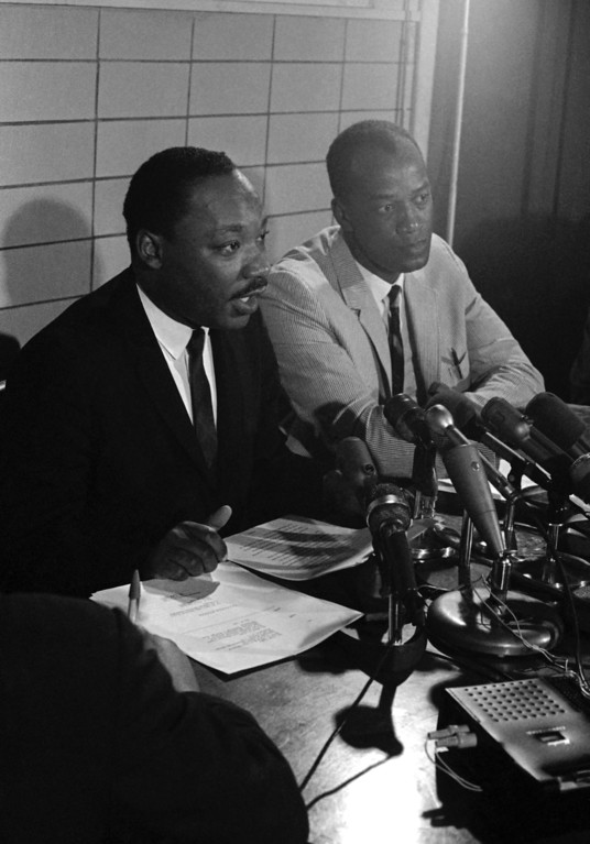 . Dr. Martin Luther King Jr., facing a battery of microphones, tells a news conference in Chicago that Congress is partly to blame for massive race rioting across U.S. cities, July 26, 1967.  King, head of the Southern Christian Leadership Congress, was in Chicago to announce an adult education project for Lawndale, a Chicago suburb, and center of one of last summer?s riots. (AP Photo/Larry Stoddard)