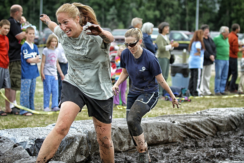 TJ Strawn and Jackie Seiffert race to get out of the mud..