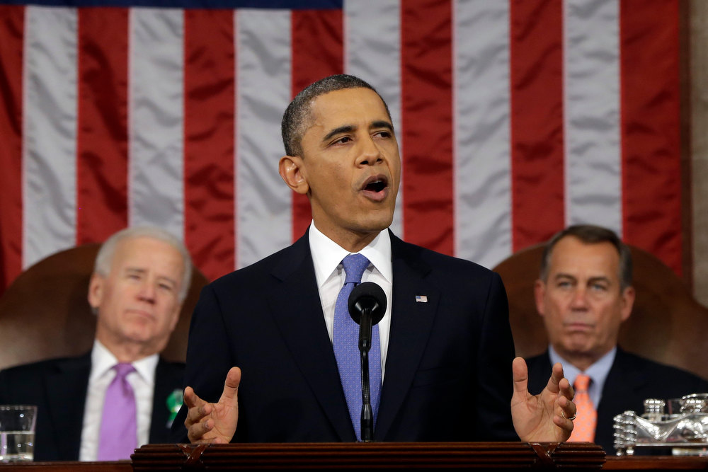 Description of . President Barack Obama, flanked by Vice President Joe Biden and House Speaker John Boehner of Ohio, gives his State of the Union address during a joint session of Congress on Capitol Hill in Washington, Tuesday Feb. 12, 2013. (AP Photo/Charles Dharapak, Pool)