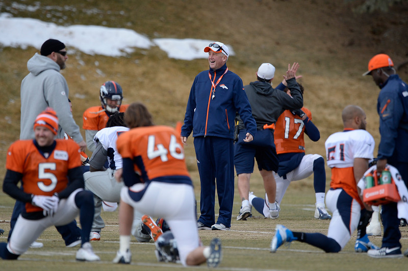 . Denver Broncos head coach John Fox smiles as the tea stretches before practice January 15, 2014 at Dove Valley. The Broncos are preparing for their game against the New England Patriots in the AFC championship game.  (Photo by John Leyba/The Denver Post)