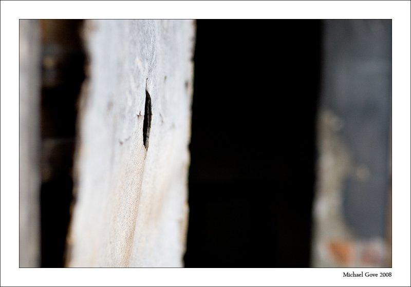 Peep hole into the Gas chamber  Crematorium (94618843).jpg