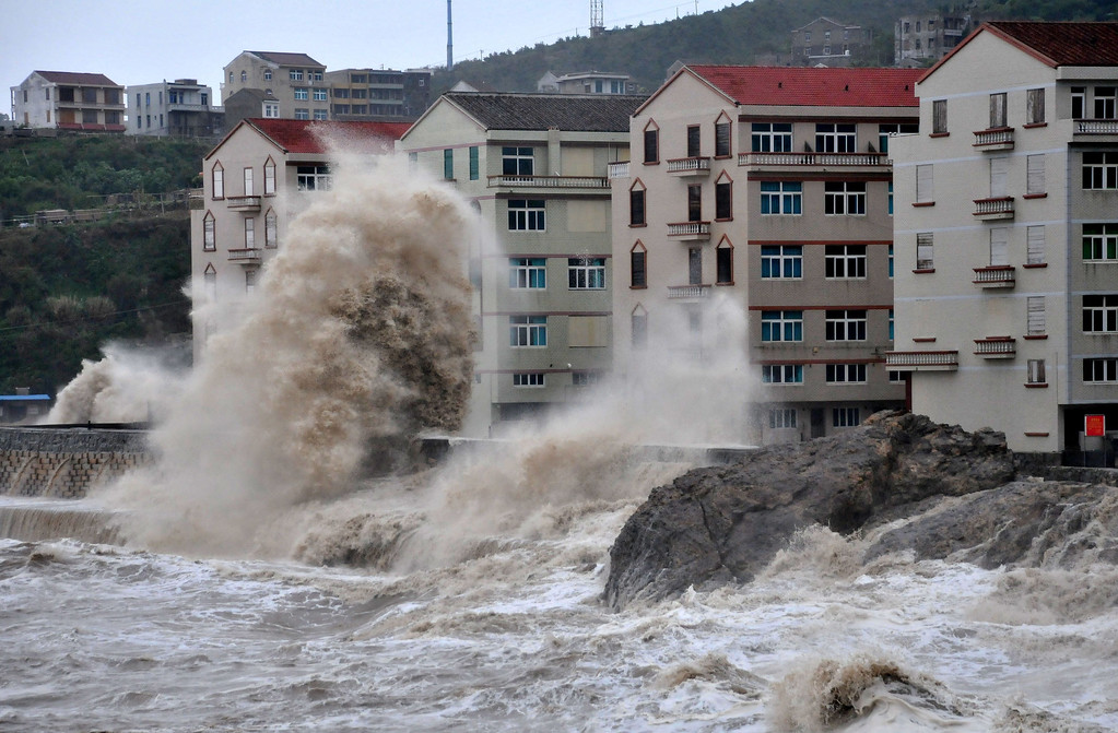 . Huge wave hits the dike as Typhoon Fitow moves to make its landfall in Wenling, east China\'s Zhejiang province on October 6, 2013.  China was on its highest alert for Typhoon Fitow on October 6, with tens of thousands evacuated as the storm was set to slam into the east coast.   STR/AFP/Getty Images