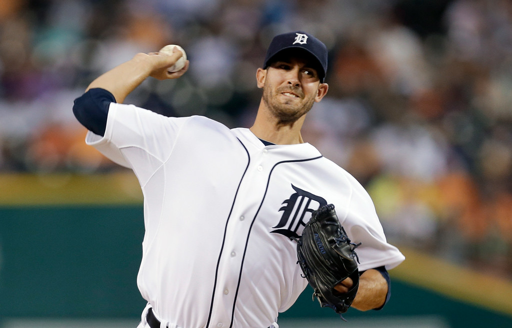 . Detroit Tigers pitcher Rick Porcello throws against the New York Yankees in the first inning of a baseball game in Detroit Tuesday, Aug. 26, 2014. (AP Photo/Paul Sancya)