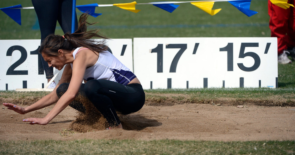 . DENVER, CO. - APRIL 13TH: Ashley Steck, Douglas County High School, lands in the sand pit during the girls long jump competition at the Mullen Runners Roost 2013 Track and Field Invitational at Mullen High School, Saturday April, 13th 2013.(Photo By Andy Cross/The Denver Post)