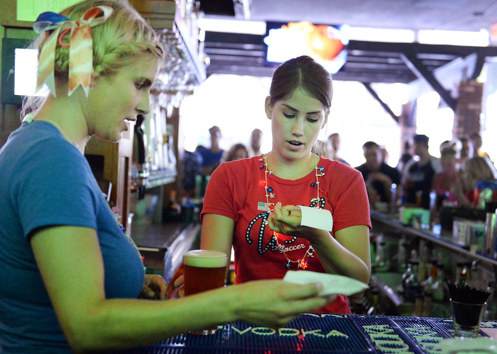 . A server and bartender gather drinks during the USA vs Belgium world cup game viewing party on Tuesday, July 1, 2014 at Darby\'s American Cantina in Redlands, Ca. (Photo by Micah Escamilla/The Sun)