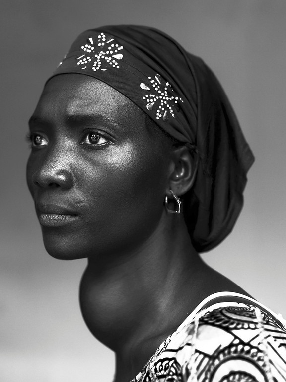 """. Stephan Vanfleteren of Belgium, a Panos photographer working for Mercy Ships/De Standaard, has won the first prize in the People - Staged Portraits Stories category of the World Press Photo Contest 2013 with the series \""""People of Mercy, Guinea\"""". The picture shows Makone Soumaoro, 30,  who has a goiter, in Conakry, taken on October 17, 2012 and distributed by th REUTERS/Stephan Vanfleteren/Panos/World Press Photo/Handout"""