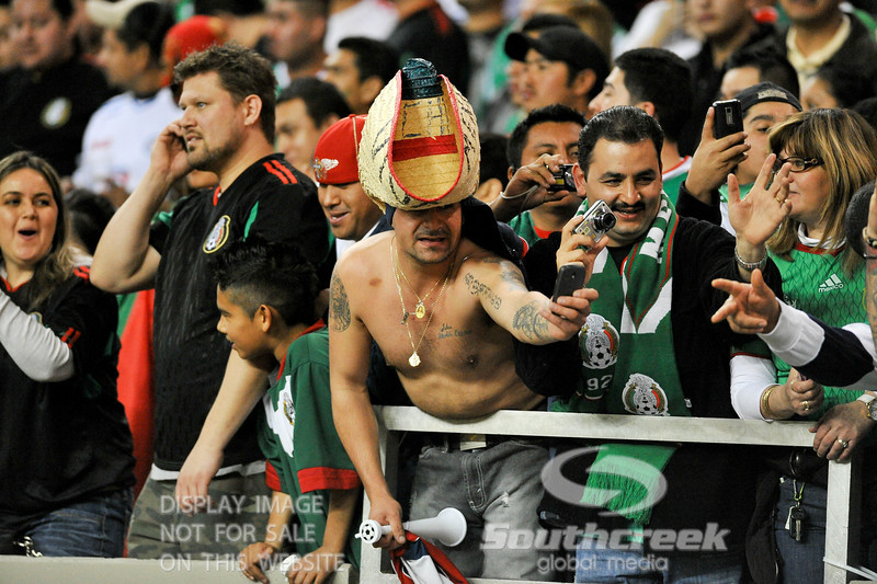 Mexico fans take pictures during Soccer action between Bosnia-Herzegovina and Mexico.  Mexico defeated Bosnia-Herzegovina 2-0 in the game at the Georgia Dome in Atlanta, GA.