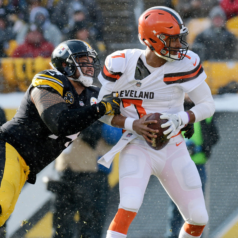 . Cleveland Browns quarterback DeShone Kizer (7) is sacked by Pittsburgh Steelers defensive end Tyson Alualu (94) during the first half of an NFL football game in Pittsburgh, Sunday, Dec. 31, 2017. (AP Photo/Don Wright)