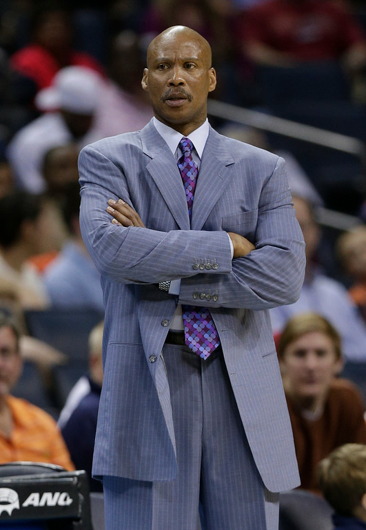 . Cleveland Cavaliers head coach Byron Scott looks on during the first half of an NBA basketball game against the Charlotte Bobcats in Charlotte, N.C., Wednesday, April 17, 2013. (AP Photo/Chuck Burton)