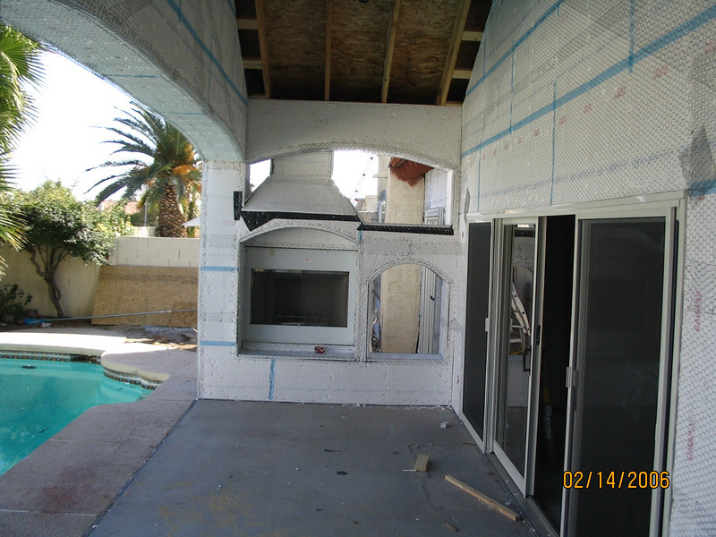 Looking at the fireplace, with the sliding doors on the right.
