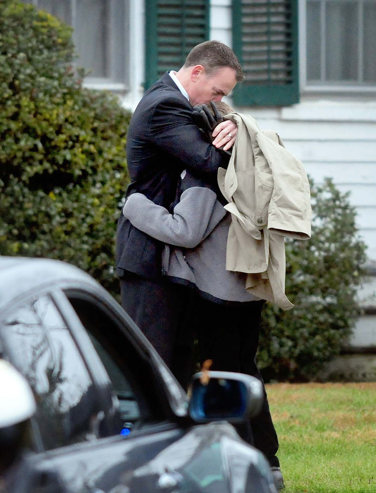 Description of . Mourners embrace before entering the Honan Funeral Home in Newtown on 12/17/2012 for funeral services for six-year-old Jack Pinto, a victim of the Sandy Hook Elementary School shootings. Photo by Arnold Gold/New Haven Register
