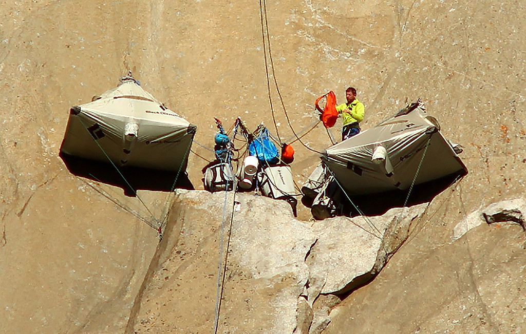 . In this Dec. 28, 2014 photo, Tommy Caldwell, 36, of Estes Park, Colo., with Kevin Jorgeson, 30, of Santa Rosa, Calif., not seen, set up camp as they begin what has been called the hardest rock climb in the world: a free climb of a El Capitan, the largest monolith of granite in the world, a half-mile section of exposed granite in California\'s Yosemite National Park. (AP Photo/Tom Evans, elcapreport)