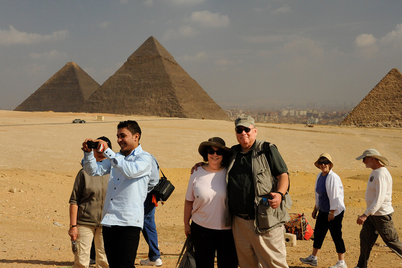 Renee and Ellis at the Giza Plateau.  Pyramids in the background are (from the left) the Great Pyramid of Khufu, the Pyramid of Khafre (son of Khufu) and the Pyramid of Menkaure (aka Mycerinus; son of Khafre; southernmost, to the right)._D7C8092