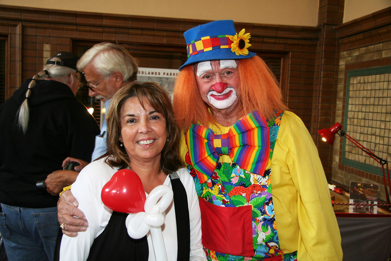 Arleene with a clown at one of the vendor booths